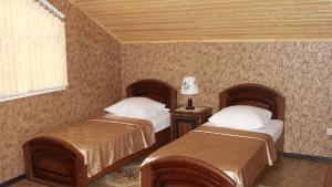 Кровать или кровати в номере Гостевой Дом Planeta MOV