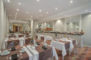Een restaurant of ander eetgelegenheid bij Grand Hotel de l'Opera - BW Premier Collection