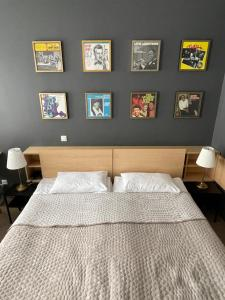 A bed or beds in a room at Jazz Hotel Navalis, Tubinas Hotels