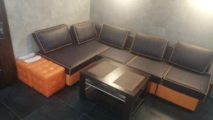 A seating area at GOOD POINT Boutique Hotel