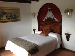 A bed or beds in a room at El secreto del Castillo