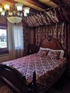 A bed or beds in a room at Dream of Baikal Hotel