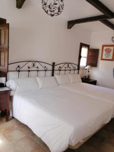 A bed or beds in a room at Hotel Rural Xerete