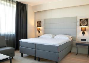Voodi või voodid majutusasutuse Tallink City Hotel toas