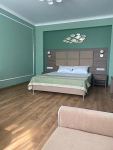 Кровать или кровати в номере Отель Черноморская