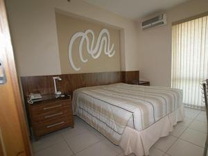 A bed or beds in a room at Flat Setor Hoteleiro Norte
