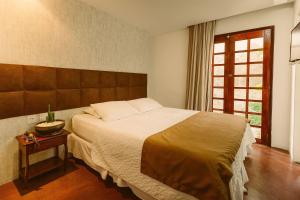 A bed or beds in a room at Vivaz Boutique Hotel