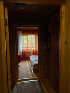 Кровать или кровати в номере Zona otdyha Istra