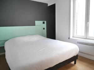 Un ou plusieurs lits dans un hébergement de l'établissement Le Chat Qui Dort