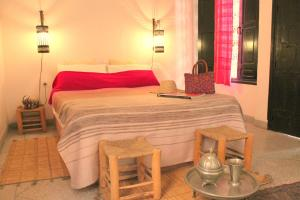 A bed or beds in a room at Dar Choumissa