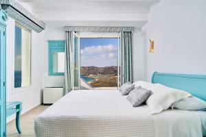 A bed or beds in a room at Arte & Mare Elia Luxury Suites & Vllas