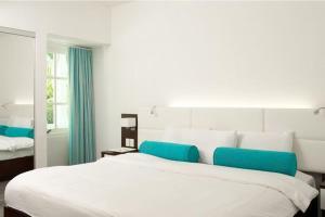 Cama ou camas em um quarto em Trupial Hotel & Casino