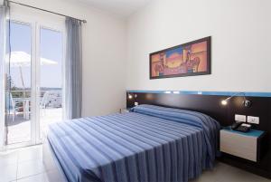 Letto o letti in una camera di Miramare Hotel