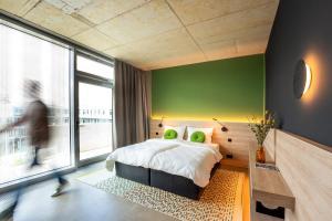 Ein Bett oder Betten in einem Zimmer der Unterkunft Koncept Hotel Josefine