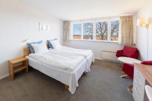 En eller flere senge i et værelse på Hotel Pepita