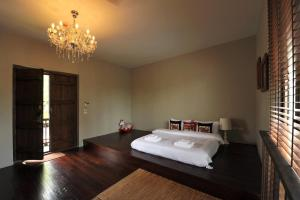 Letto o letti in una camera di Villa Phra Sumen Bangkok
