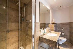 Ein Badezimmer in der Unterkunft Hotel Am Yachthafen