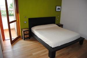 A bed or beds in a room at Agriturismo La Sassicaia