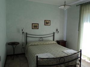 Letto o letti in una camera di Agriturismo Poggio Torreano
