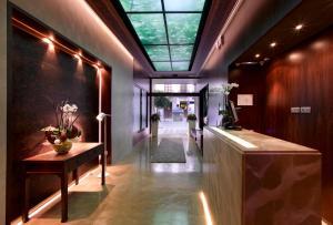 El salón o zona de bar de Hotel Abades Recogidas