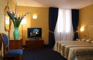 Cama ou camas em um quarto em Hotel Castello