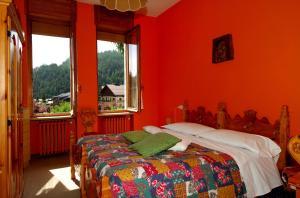 A bed or beds in a room at Villa Myosotis