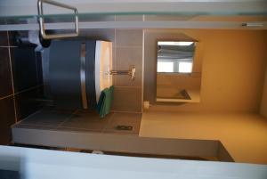 Ein Badezimmer in der Unterkunft Guest House Feliz