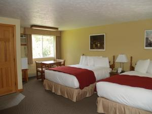 A bed or beds in a room at Wilson Lake Inn