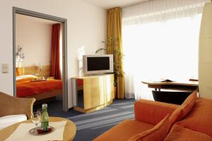 A television and/or entertainment center at Apartment-Hotel Schaffenrath