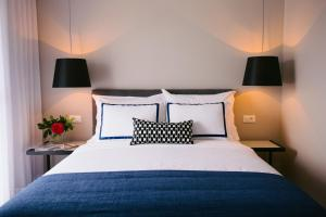 A bed or beds in a room at Hotel Osam - Adults Only