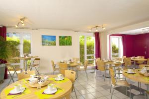 Ein Restaurant oder anderes Speiselokal in der Unterkunft Séjours & Affaires Toulouse de Brienne