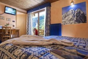 Ein Bett oder Betten in einem Zimmer der Unterkunft Miramonti