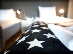 Säng eller sängar i ett rum på Port Hotel