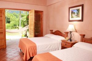 A bed or beds in a room at La Villa de Soledad