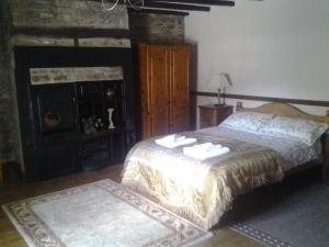 A bed or beds in a room at The Old Mill