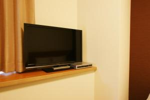 A television and/or entertainment center at Hotel Century Art