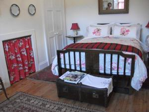 A bed or beds in a room at Beachborough Country House