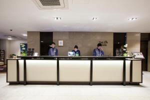 Staff members at The Grand Hotel Myeongdong