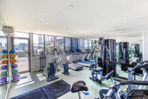 The fitness center and/or fitness facilities at Piper - Beyond a Room Private Apartments