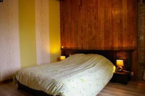 Un ou plusieurs lits dans un hébergement de l'établissement Gite au Chalet