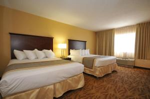A bed or beds in a room at Kahler Inn and Suites