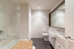 A bathroom at Piper - Beyond a Room Private Apartments