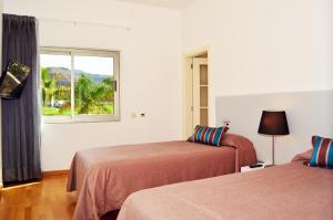 Cama o camas de una habitación en Villas Opal Anfi Tauro