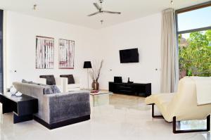 Zona de estar de Villas Opal Anfi Tauro