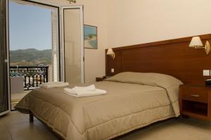 Кровать или кровати в номере Hotel El Greco