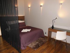 Łóżko lub łóżka w pokoju w obiekcie Apartament Studio Przy Deptaku