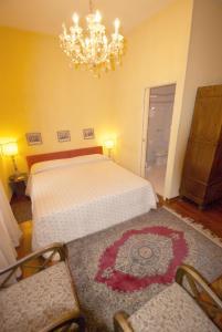 Letto o letti in una camera di Locanda Borgonuovo