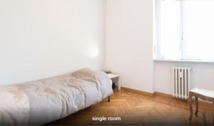 A bed or beds in a room at B&B Quadrifoglio