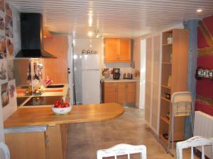 A kitchen or kitchenette at Appartement Le Chez Soi Riquewihr