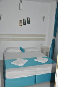 A bed or beds in a room at Hotel Nisa